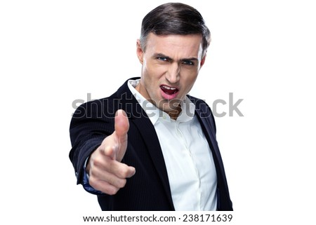 Businessman pointing his hand like a gun to the camera - stock photo
