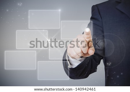 businessman pointing hologram whit finger on a glowing background - stock photo