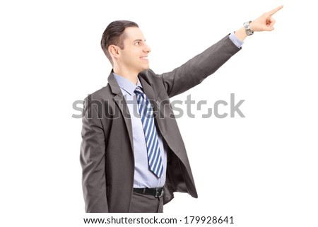Businessman pointing in a direction, isolated on white background