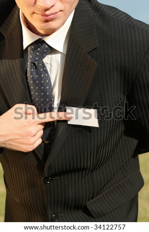 businessman pointing on empty card with finger