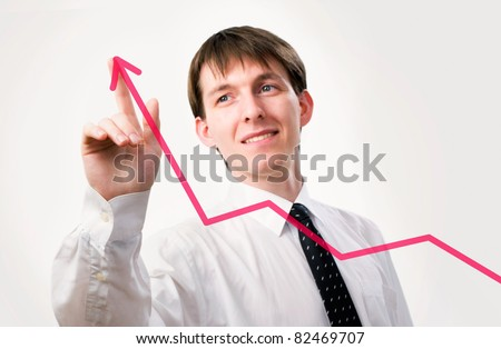 Businessman pointing on the graph in an office - focus is on graph