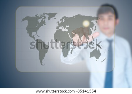 Businessman pointing on world map - stock photo