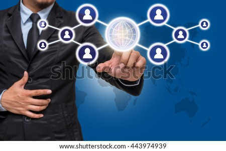 Businessman pointing or touching the Social media symbol on blue color background with world map,Elements of this image furnished by NASA, Business network concept - stock photo