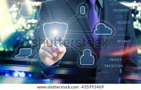 Businessman Pointing Shield Icon of Virtual Touchscreen in Internet Security Concept Image - stock photo