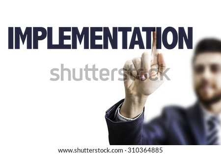 Businessman pointing the text: Implementation - stock photo