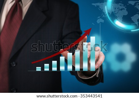 Businessman pointing to a growth chart on virtual touch screen