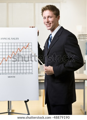 Businessman pointing to chart - stock photo