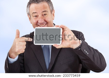 Businessman pointing to his Tablet PC - stock photo