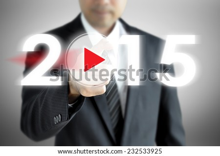 Businessman pointing  to 2015 on virtual screen - stock photo