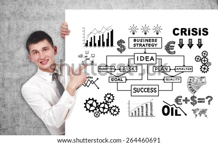 businessman pointing to poster with drawing business strategy - stock photo