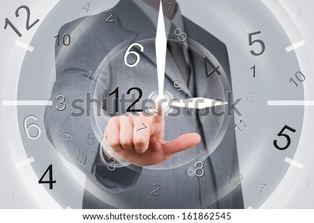 businessman pointing to the center of a chaotic clock - stock photo