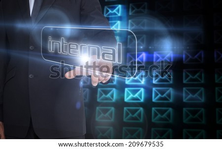 Businessman pointing to word internal against digital envelope background