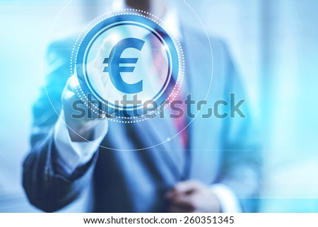 Businessman pointing towards camera selecting euro symbol , virtual interface