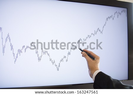 businessman pointing with pen purchase area on the monitor