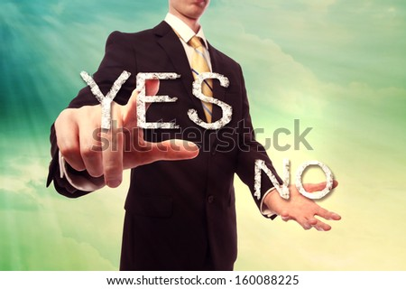 Businessman pointing YES over turquoise yellow colored sky background - stock photo