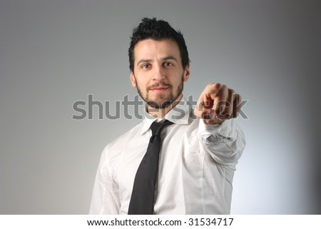 businessman pointing you with a finger - stock photo