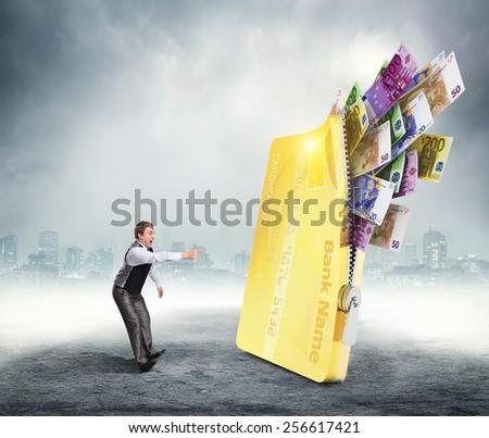 Businessman points at money - stock photo