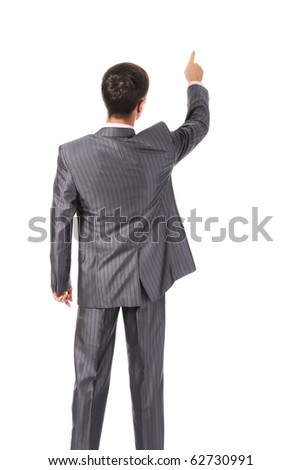 Businessman points finger up. Isolated on white - stock photo
