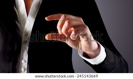 Businessman points his finger. - stock photo