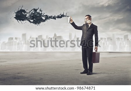 Businessman polluting the air of a big city with a spray can - stock photo