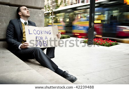 Businessman portrait looking for a job in urban background - stock photo