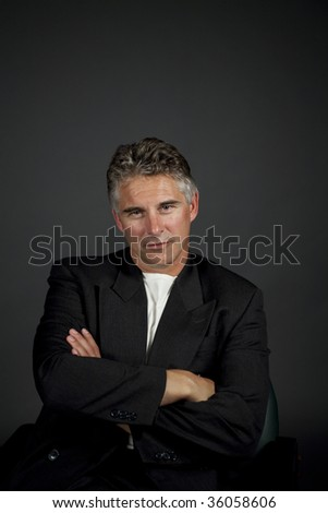 businessman portrait shot over grey background