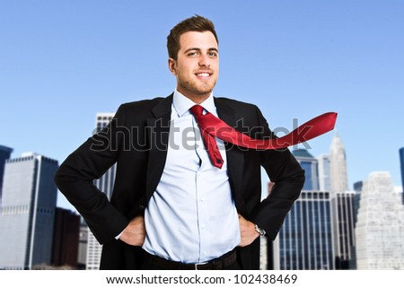 Businessman posing as a superhero - stock photo