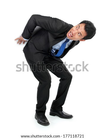 Businessman posing for conceptual photo. man holding something on his back