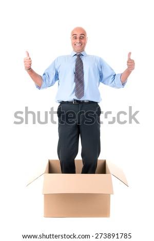 Businessman posing inside a cardboard box - stock photo