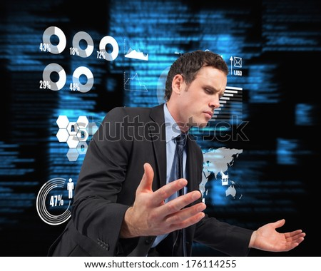 Businessman posing with arms out against blue blurred texts