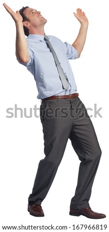 Businessman posing with arms raised on white background - stock photo