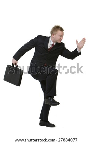 Businessman posing with briefcase