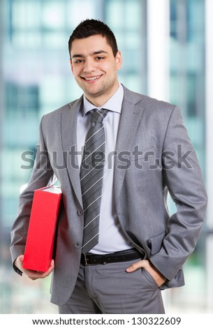 Businessman posing with folder in his hands.