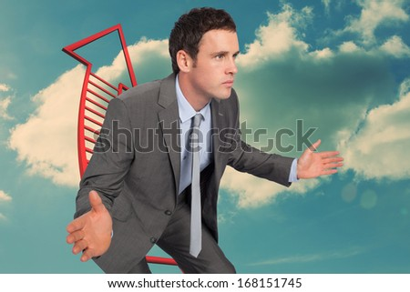 Businessman posing with hands out against red ladder arrow pointing up against sky