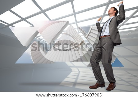 Businessman posing with hands up against white room with windows at ceiling