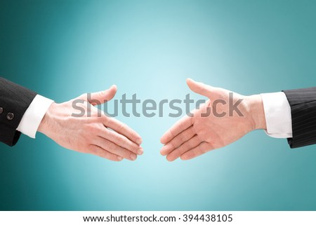 businessman positive deal with handshake isolated on blue