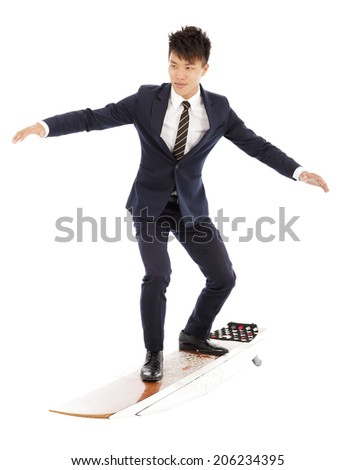 businessman practice surfing pose with suit - stock photo