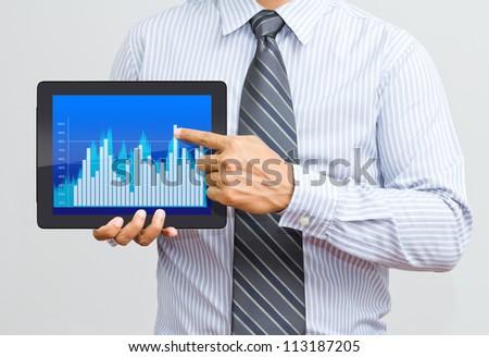 Businessman present a chart on digital tablet - stock photo