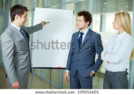 Businessman presenting a new project to colleagues - stock photo