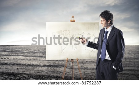 Businessman presenting a world map - stock photo