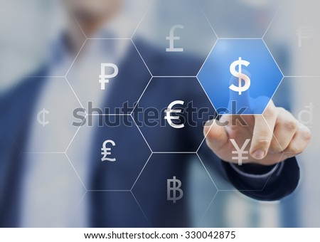 Businessman presenting currencies on virtual screen and touching dollar sign - stock photo