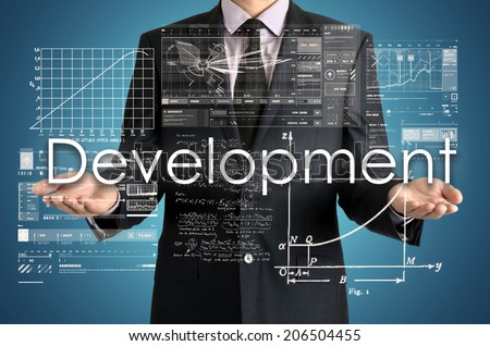 businessman presenting Development concept of his own hands:  - stock photo