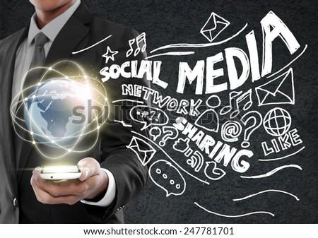 Businessman presenting global network social media concept - stock photo