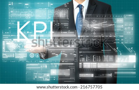 businessman presenting KPI  text and graphs and diagrams with skyscraper in background