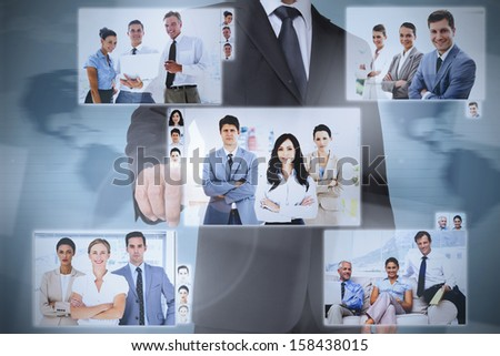 Businessman presenting pictures of coworkers on digital interface - stock photo