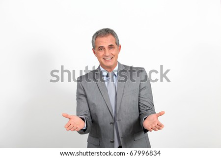 Businessman presenting project looking at camera - stock photo
