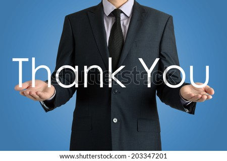 businessman presenting sign Thank You with their hands - stock photo
