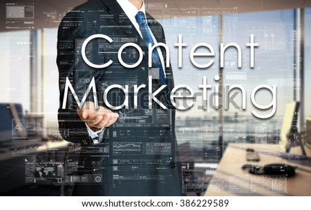 Businessman presenting text Content Marketing on virtual screen. He is in the office - stock photo