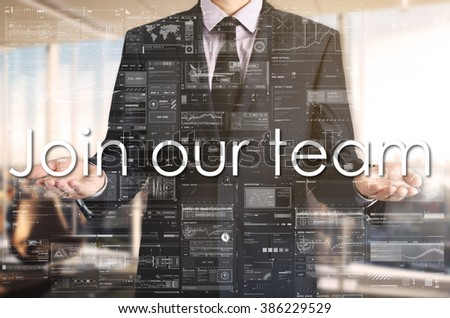 Businessman presenting text Join Our team on virtual screen. He is in the office - stock photo