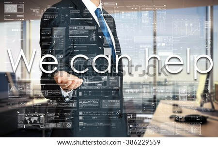 Businessman presenting text We can help on virtual screen. He is in the office - stock photo